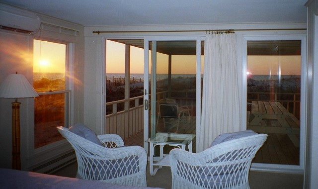 The master bedroom view from the king bed shows only ocean and beach.