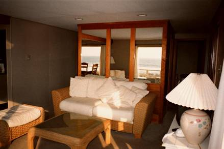 The second floor living room photo above shows the mirrored wall that reflects your ocean view.